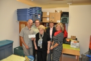 Outgoing NDCU director makes presentation to Nelson Food Cupboard Society