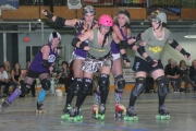 And the action was intense from the opening whistle between the Killjoys (grey) and Dam City Rollers.