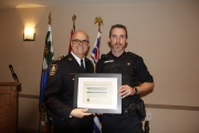 NPD Chief Constable Paul Burkart presents Cst. Chris Duncan with the Chief Constable's Commendation for Bravery, Good Judgement and Dedication.