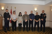 Nelson Police Cst. Alain Therrien, Nelson Police Board Chair and Mayor Deb Kozak and Sgt. Dino Falcone (far right) present Long Service Pins to Nelson Reserves, (from left) Shelley Stewart, Steve Donald, Mark Young and Brent Tipple.