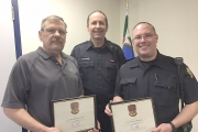 Nelson Police Sergeant Dino Falcone presents Retired Cst. Bill Andreaschuk (left) and Cst. Dan Markevich (right) with the Outstanding Traffic Team honour.