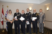 Nelson Police Board Chair and Mayor Deb Kozak and NDP Board Director Am Naqvi (far right) present Long-Service Awards to, from left, Retired Cst. Bill Andreaschuk, Retired Cst. Paul Jacobsen, Cst. Dave Liang and NPD Chief Constable Paul Burkart.