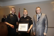 Nelson Police Cst. Chris Duncan and Police Board Director Bill Reid present Steve Rigby with Commendation for Observation and Calm Demeanor.