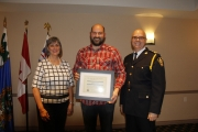 Nelson Police Board Chair and Mayor Deb Kozak and NPD Chief Constable Paul Burkart present Dwight Weiers of Saskatchewan with the NPD Board Commendation for Willingness to assist/Commitment to Community award. During the Nelson Credit Union robbery in Weiers gave up his vehicle to a NPD member to help assist in the arrest of the two robbers.