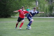 After a slow start, the U18 Boys and Bryce Twible (blue) rallied past Kootenay South.