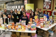 Students in Selkirk College's School of Health & Human Services helped collect items for the Selkirk College Food Bank at the Saints hockey game on Friday night. Students are pictured here with Selkirk College staff and members of the Saints hockey team.