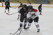 Midway Black Betties (white) and Thorman Drillers battled to a 2-2 tie Saturday at the Civic Centre Arena. — Bruce Fuhr photo