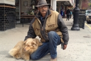 "Robin Edgar-Haworth and his Aussie Shepherd Koda, stopped briefly in Nelson Monday as part of his 5,000 kilometer ""Right the Wrong"" walk to Ottawa. — Bruce Fuhr photo, The Nelson Daily"