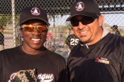 Quin Hall of Nelson is pictured with former picture Albie Lopez during a tournament in Arizona. Lopez, an 11-year-pro, was a member of the 2003 World Champion Arizona Diamondbacks and is coach for the BC select team. — Submitted photo
