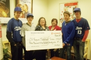 Bomber players joined forces with staff at the local Nelson Scotia Bank for a cheque presentation photo. — Submitted photo