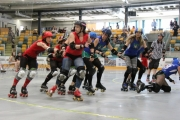 Rossland's Gnarlies Angels, seen in red against the Babes of Bruitality of Salmo, have combined with Trail this season.