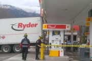 Nelson Fire Rescue members tape off the area around the gas pumps after a Ryder rental truck became lodged under the canopy at the Shell Station on Nelson Avenue Wednesday. — Photo courtesy Nelson Fire Rescue