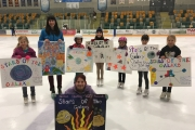 Makayla Pickering (front) and the rest of Nelson skaters display posters for the upcoming Stars of the Galaxy year end show May 6 at the NDCC Arena. — Submitted photo