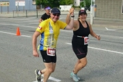Peter and Danica Lee were all smiles en route to the finish line at Sunday Penticton Ironman. — Submitted photo