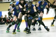 The Babes from Salmo (blue) are in the final of the West Kootenay Women's Flat Track Roller Derby League after disposing of Castlegar's Dam City Rollers Friday in Rossland. — Bruce Fuhr file photo