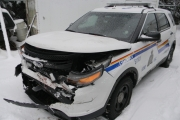 Police released picture of the marked police cruiser rammed early Monday morning that began a manhunt that led to the arrest of a 35-year-old man. — Photo courtesy RCMP