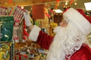 Santa picks the candy he'll be giving out Friday to the children during his trip to Nelson.