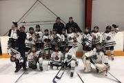 The silver medal winning Atom Leafs include, L-R, Coaches Leif Luttmer, Brian Jones and Kevin Dewar holding Sebastian Conne-Correnti. Players back row,  Levi Konken, Dane Jones, Miles Cousins, Jaden Hlookoff, Gunner Evenson, Nathan Jackman, Cash Nay, Cohen Wolbaum and Cash Linnen. Front: Larson Proctor, Mitchell Erickson, Dax Dewar and goalie Shea Andersen. — Submitted photo