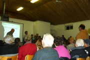 Senior Fish biologist Jeff Burrows (center by screen) presents information to a packed house. — Suzy Hamilton photo