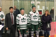 Leaf Treasurer Karilynn Carr makes a presentation before Monday's KIJHL playoff game at the NDCC Arena tothree graduating players, from left, goalie Billy Gorn and forward Sam Weber and Dale Howell. — Photo courtesy Nelson Leafs
