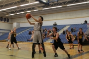 Bomber forward Jairo Mangapot goes to the basket during action against Mount Sentinel Wildcats Friday at the LVR Junior Boy's Basketball Tournament at the Hangar. — Bruce Fuhr, The Nelson Daily