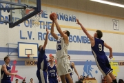 Leo Weiss goes to the hoop for two of his 23 points during Friday's come-from-behind win over Selkirk Storm of Kimberley during the weekend L.V. Rogers Senior Boy's Basketball Tournament Friday at the Hangar. — Sarah Fuhr photo, The Nelson Daily
