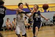 Cats Oliver Cougar passes in the paint during the win over Nakusp. — Sarah Fuhr photo