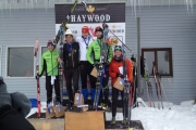 Nelson's Julien Locke stands on top of the podium with skis held high after winning gold at the Haywood NorAm World Junior and U23 Championships Thursday at Lappe Nordic Ski Centre near Thunder Bay, Ont. — Submitted photo