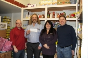 The Nelson Daily Ad Manager John McCuaig (far left) and TND Owner Bruce Fuhr (far right) present Food Bank Coorinator David Sprague and Drop In Centre Volunteer Coordinator Simone Peland with a cheque to help during the busy season. — Jessica Fuhr photo