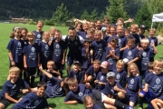 During a break at the camp, players got together for a team photo with Marcos Bustos of the Vancouver Whitecaps. — Submitted photo