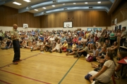 Incident Commander Glen Burgess fields questions from the crowd during a public meeting held at école de Sentiers-alpins Wednesday evening concerning the Sitkum Creek-Duhamel Wildfire. — Eva Brownstein photo, The Nelson Daily