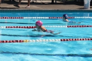 Two Neptune swimmers cut through the waters of the Salmo Pool at the first meet of the KSSA season. — Submitted photo