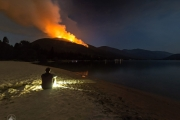 After getting the word of an evacuation alert, Ryan  Flett watched the fire burn from 7-Mile beach. — Ryan Flett photo