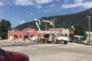 Crews installed the pedestrian crosswalk sign at the interestion of Vernon and Stanley Street in Nelson. — The Nelson Daily