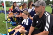 After filling the net, Naomi Perkins (sitting beside co-coach Mike Gerun) takes a break during Nelson's 6-1 win in the bronze medal at the BC Soccer Provincial B Girl's Championship Sunday in Chilliwack. — Photo courtesy Tanis Bouchier