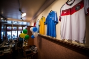 Jerseys from teams in the 2014 World Cup line the wall at the Main Street Diner. —Nick Diamond Photography