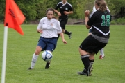 Haliee Gerun takes on an East Kootenay defender Saturday at Lakeside Pitch. — Bruce Fuhr photo