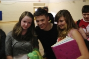 Shawn Hook poses for photos with a few fans following a jam session Friday at Mount Sentinel High School gymnasium. — Bruce Fuhr photo