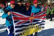 From left, David Palmer of Revelstoke, Nelson's Julien Locke, Geoffrey Richards of Rossland and Colin Ferrie of Kimberley pose for photo with BC Flag after capturing the bronze medal in the men's team race Saturday at the Canada Winter Games in Prince George. — photo courtesy Lia Threlfall of TeamBC