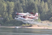 Firefighting aircraft picks up water during the fighting of the Slocan Park Wildfire in August 2014. — The Nelson Daily file photo
