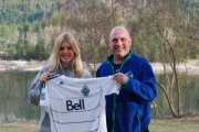 Select coordinator Dave Grantham presents Maddie Van Horn with an official Whitecaps jersey after Van Horn won the contest to select the new logo for Kootenay South Rep Teams. — Submitted photo