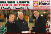 "Leaf present Larry Martel (far right) presents Bill McDonnell (center) and Denis Kleine with a cheque for ""Man in Motion"" project during a recent Leaf playoff game. — Bruce Fuhr photo"