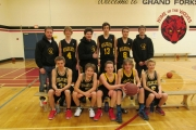 The West Kootenay Champion Wildcats include, back row, L-R, assistant coach Dale Soukeroff, Logan Miller, Dylan Bowolin, Aaron Abrosimoff, Brandon Soukeroff and coach Devon Kabatoff. Front, Benn Leidoff, Daniel Stewart, Sammy Sopow, Kie Miller and Matthew Falle.  Missing, Rory Smith and Erin Cork. — Submitted photo