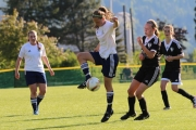U16's Grace Dehnel secures the ball for the host club during a game against Kootenay South. — Bob Hall photo