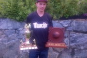 Brendan Martel holds the Rollie Lussier and Dean Wells Memorial trophies won last year. — Submitted photo