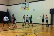 The Eagles (white) run an end zone play during action at the Kelowna Basketball Tournament. — Submitted photo