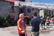 Nelson Fire Chief Simon Grypma discusses the cause of a fire Friday morning on Railway Street. — Photo courtesy Nelson Fire Department