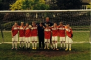 The winning U11 squad, with coach Dave Spendlove behind, went undefeated in Surrey.
