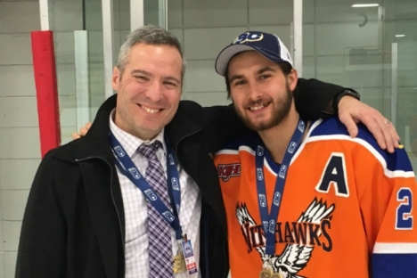 Nelson native Nolan Percival shares a photo with Hawks head coach Terry Jones following Sunday's Cyclone Taylor Cup victory in Creston. — Submitted photo