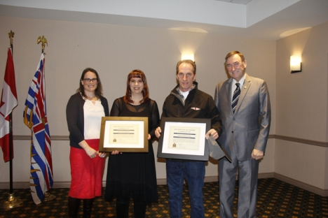 Nelson Police Board Director Liz Edwards, left, and Bill Reid (far right) present Deana Postnikoff and Vincent O'Dea with Board Commendation for Willingness to take lifesaving action during the 2017 Commendations Ceremony Wednesday afternoon at the Baker Street Best Western. — Bruce Fuhr photos